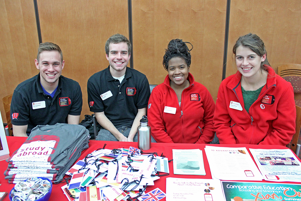 Two male and two female students at an international studies campus event; funding opportunities for UW Madison international studies campus units